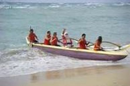 Santa arrives in a canoe for Christmas on Kauai 2012